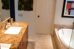 Master Bathroom Tub, Sinks, and Door to Walk in Closet