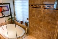Master Bathroom Custom Shower Decorative Tile Walls and Frameless Glass Enclosure
