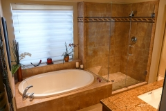 Master Bathroom with Built-in Tub and Custom Shower with Decortive Tile Walls, Frameless Glass Shower Enclosure