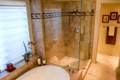 Master Bathroom with Built in Tub and Custom Shower with Decortive Tile Walls, Frameless Glass Shower Enclosure